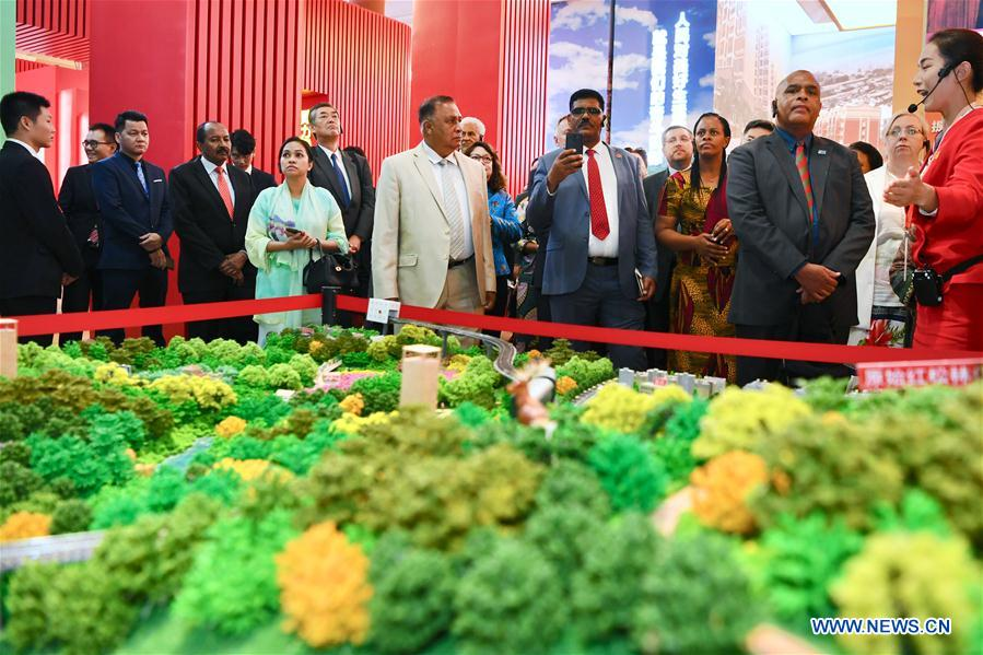 Foreign ambassadors and diplomats, and representatives of international organizations visit a grand exhibition of achievements in commemoration of the 70th anniversary of the founding of the People's Republic of China (PRC) at the Beijing Exhibition Center in Beijing, capital of China, Sept. 25, 2019. (Xinhua/Jiang Kehong)
