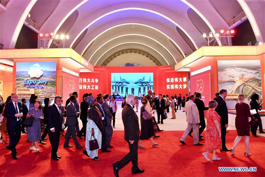 Foreign ambassadors and diplomats, and representatives of international organizations visit a grand exhibition of achievements in commemoration of the 70th anniversary of the founding of the People's Republic of China (PRC) at the Beijing Exhibition Center in Beijing, capital of China, Sept. 25, 2019. (Xinhua/Jiang Kehong)<br/>