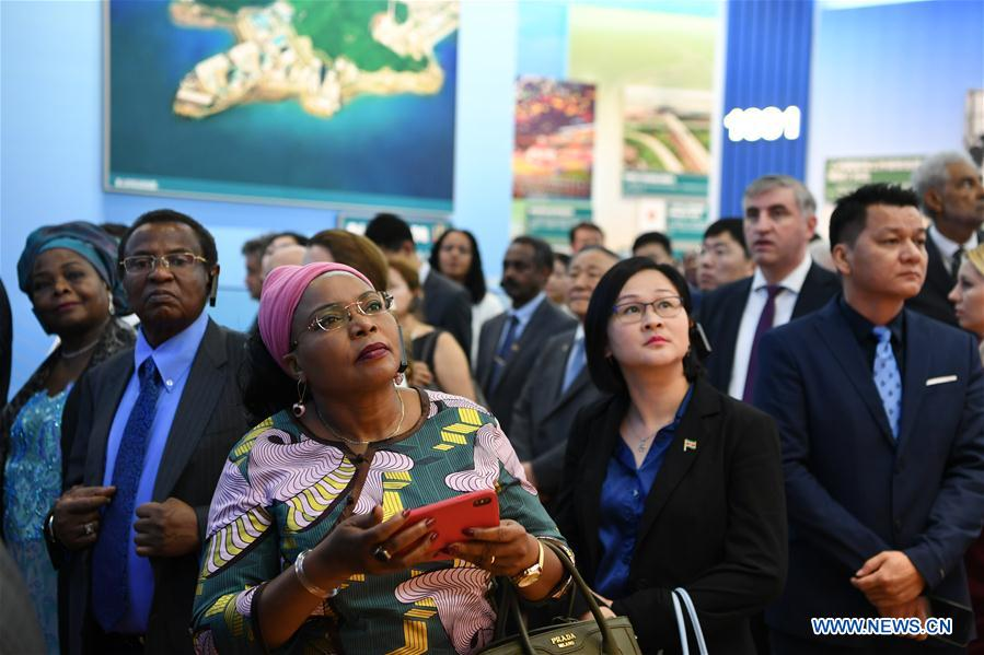 <br/> Foreign ambassadors and diplomats, and representatives of international organizations visit a grand exhibition of achievements in commemoration of the 70th anniversary of the founding of the People's Republic of China (PRC) at the Beijing Exhibition Center in Beijing, capital of China, Sept. 25, 2019. (Xinhua/Jiang Kehong)<br/>