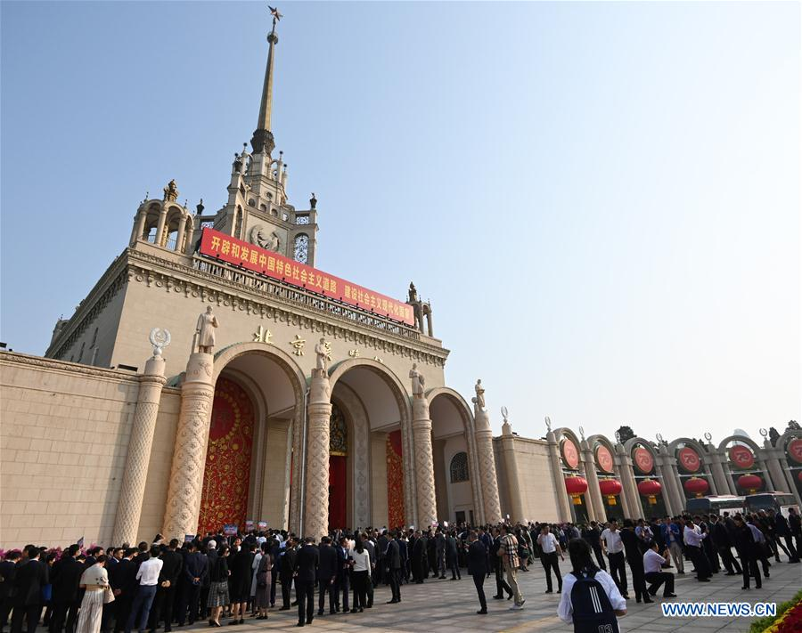 <br/> Oversea Chinese wait to visit a grand exhibition of achievements in commemoration of the 70th anniversary of the founding of the People's Republic of China (PRC) at the Beijing Exhibition Center in Beijing, capital of China, Sept. 28, 2019. Some 2,000 oversea Chinese were invited to visit the exhibition on Saturday. (Xinhua/Chen Yehua)<br/>