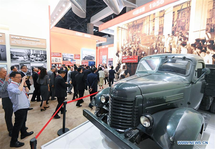 <br/> Oversea Chinese visit a grand exhibition of achievements in commemoration of the 70th anniversary of the founding of the People's Republic of China (PRC) at the Beijing Exhibition Center in Beijing, capital of China, Sept. 28, 2019. Some 2,000 oversea Chinese were invited to visit the exhibition on Saturday. (Xinhua/Chen Yehua)
