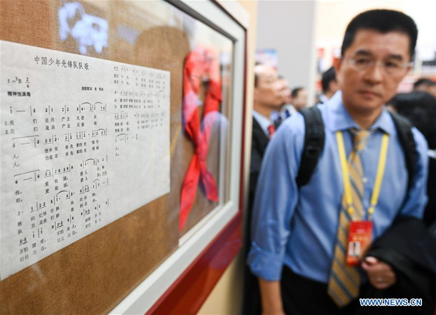<br/> Oversea Chinese visit a grand exhibition of achievements in commemoration of the 70th anniversary of the founding of the People's Republic of China (PRC) at the Beijing Exhibition Center in Beijing, capital of China, Sept. 28, 2019. Some 2,000 oversea Chinese were invited to visit the exhibition on Saturday. (Xinhua/Chen Yehua)<br/>