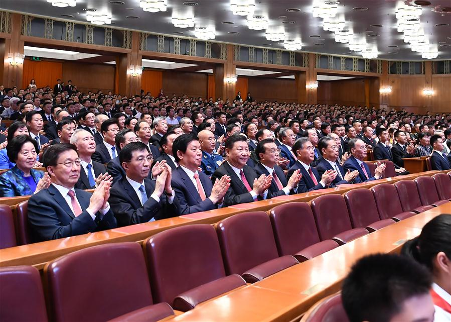 "Xi Jinping, Li Keqiang, Li Zhanshu, Wang Yang, Wang Huning, Zhao Leji, Han Zheng and Wang Qishan join over 4,000 people to watch a high-profile art performance, named ""Stride Forward, the Nation,"" at the Great Hall of the People in Beijing, capital of China, Sept. 29, 2019. The performance was held here on Sunday evening in celebration of the 70th founding anniversary of the People's Republic of China. (Xinhua/Xie Huanchi)<br/>"