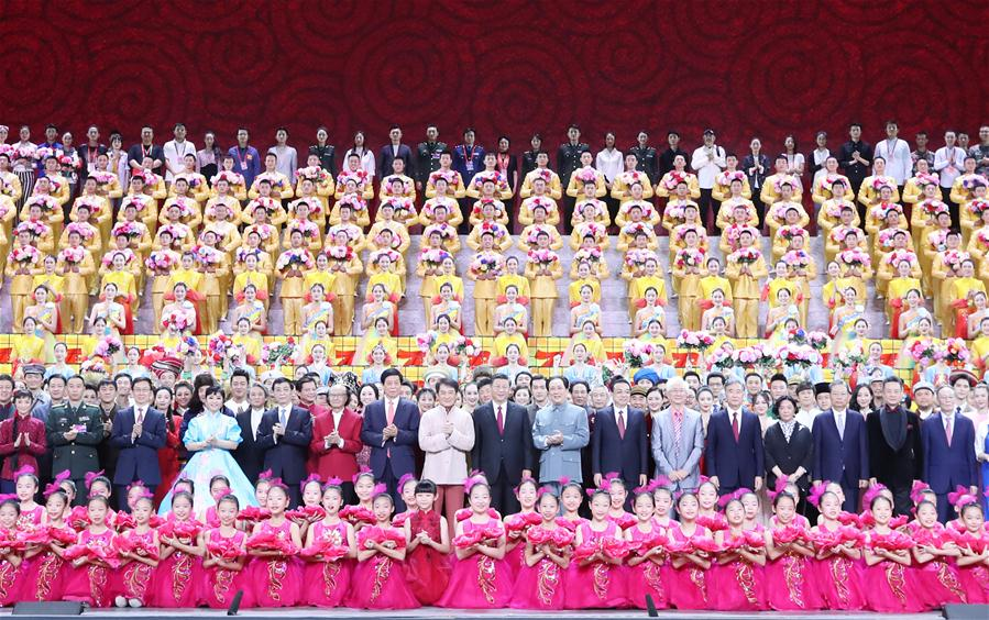 "Xi Jinping and other leaders pose for a group photo with cast members after a high-profile art performance, named ""Stride Forward, the Nation,"" at the Great Hall of the People in Beijing, capital of China, Sept. 29, 2019. The performance was held here on Sunday evening in celebration of the 70th founding anniversary of the People's Republic of China. Xi Jinping, Li Keqiang, Li Zhanshu, Wang Yang, Wang Huning, Zhao Leji, Han Zheng and Wang Qishan joined over 4,000 people to watch the performance. (Xinhua/Wang Ye)"
