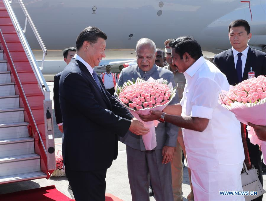 Banwarilal Purohit, governor of the Indian state of Tamil Nadu, and the state's Chief Minister Edappadi K. Palaniswami wait beside the gangway and present flowers to Chinese President Xi Jinping upon his arrival in Chennai, India, Oct. 11, 2019. At the invitation of Indian Prime Minister Narendra Modi, Chinese President Xi Jinping arrived in the southern Indian city of Chennai on Friday afternoon for the second informal meeting with Modi. (Xinhua/Ju Peng)