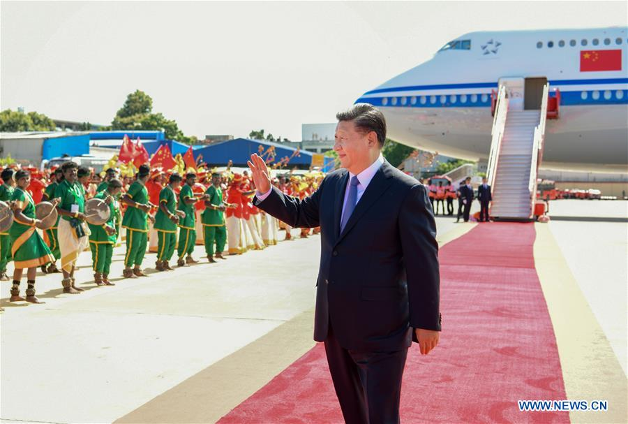 """<br/>Chinese President Xi Jinping waves to local people upon his arrival in Chennai, India, Oct. 11, 2019. At the invitation of Indian Prime Minister Narendra Modi, Chinese President Xi Jinping arrived in the southern Indian city of Chennai on Friday afternoon for the second informal meeting with Modi. (Xinhua/Xie Huanchi)<br/>At the invitation of Indian Prime Minister Narendra Modi, Chinese President Xi Jinping arrived in the southern Indian city of Chennai on Friday afternoon for the second informal meeting with Modi.<br/>Xi's flight arrived at Chennai International Airport at around 2:10 p.m. local time (0840 GMT). Banwarilal Purohit, governor of the Indian state of Tamil Nadu, and the state's Chief Minister Edappadi K. Palaniswami waited beside the gangway and presented flowers to Xi.<br/>Local people dressed in folk costumes sang and danced to welcome the Chinese president and the delegation.<br/>As Xi's motorcade departed for the city area, many local students and residents lined up in the streets, waving the Chinese and Indian national flags, holding pictures of Xi and Modi, and chanting """"China-India friendship"""" to express their warm welcome to the Chinese leader.<br/>The first informal meeting between the two leaders took place in China's central city of Wuhan in April last year.<br/>Chennai is the capital city of Tamil Nadu. Located on the Coromandel Coast off the Bay of Bengal, it is a major cultural, economic and educational center of south India.<br/>Xi will also pay a state visit to Nepal after his trip to India.<br/>"""