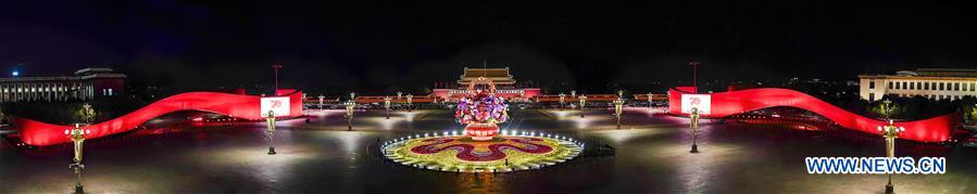Stitched photo taken on Oct. 14, 2019 shows the basket-shaped flower parterre at Tian'anmen Square in Beijing, capital of China. (Xinhua/Yin Gang)<br/>