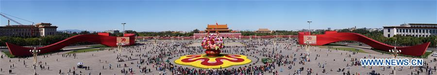 Stitched photo taken on Oct. 14, 2019 shows the basket-shaped flower parterre at Tian'anmen Square in Beijing, capital of China. (Xinhua/Yin Gang)