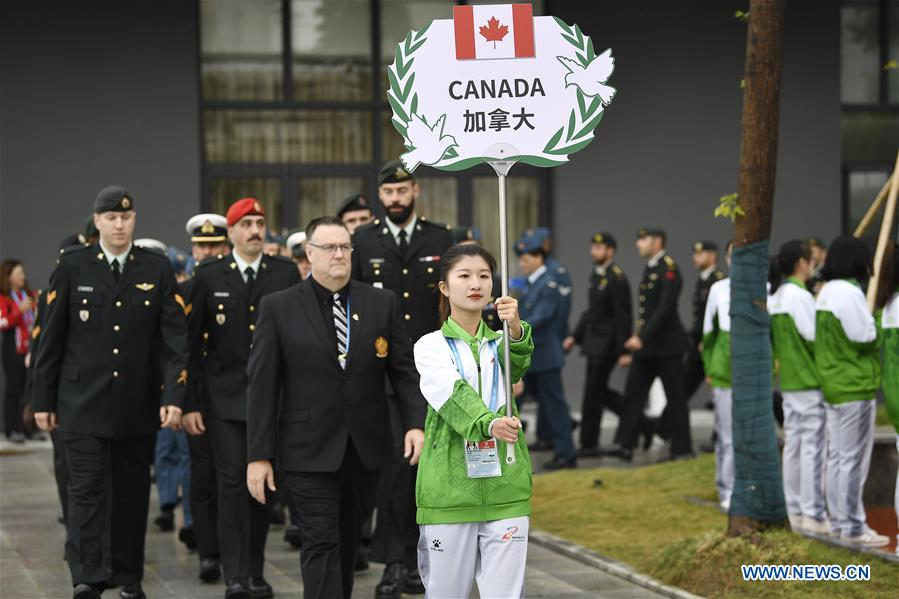 Members of the Canada delegation participate in the flag-raising ceremony at the athletes' village of the 7th International Military Sports Council (CISM) Military World Games in Wuhan, capital of central China's Hubei Province, Oct. 16, 2019.(Xinhua/Wang Peng)