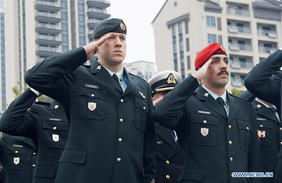 Members of the Canada delegation participate in the flag-raising ceremony at the athletes' village of the 7th International Military Sports Council (CISM) Military World Games in Wuhan, capital of central China's Hubei Province, Oct. 16, 2019.(Xinhua/Wan Xiang)<br/>