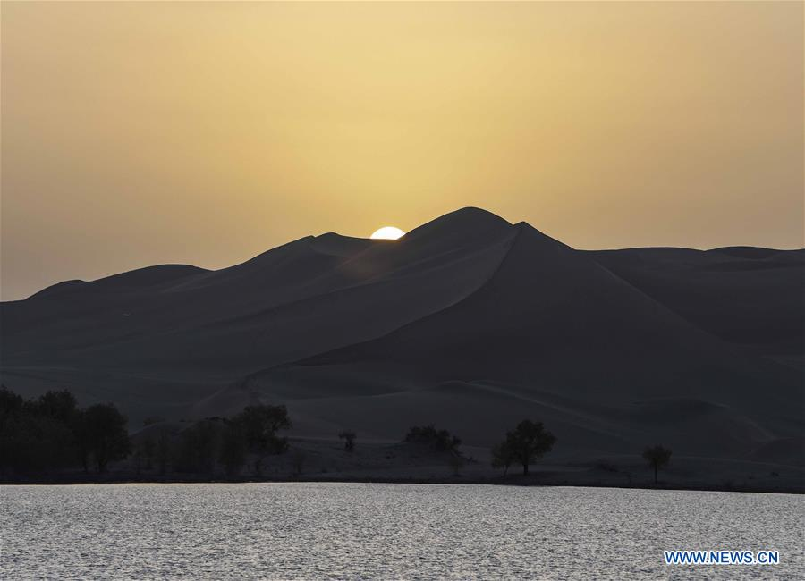 Photo taken on Oct. 25, 2019 shows the sunset scenery of Lop Nur in Yuli County, northwest China's Xinjiang Uygur Autonomous Region. In the first three quarters of this year, Xinjiang received over 183.85 million tourists from home and abroad with a year-on-year increase of 40.9 percent, and saw a total tourism revenue of more than 304.6 billion yuan (about 43.1 billion U.S. dollars) with a year-on-year growth of 40.78 percent. (Xinhua/Zhao Ge)<br/>