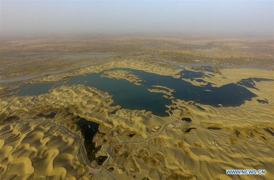 Aerial photo taken on Oct. 26, 2019 shows the scenery of Shennyu Lake scenic spot at Lop Nur People Village in Yuli County, northwest China's Xinjiang Uygur Autonomous Region. In the first three quarters of this year, Xinjiang received over 183.85 million tourists from home and abroad with a year-on-year increase of 40.9 percent, and saw a total tourism revenue of more than 304.6 billion yuan (about 43.1 billion U.S. dollars) with a year-on-year growth of 40.78 percent. (Xinhua/Zhao Ge)<br/>