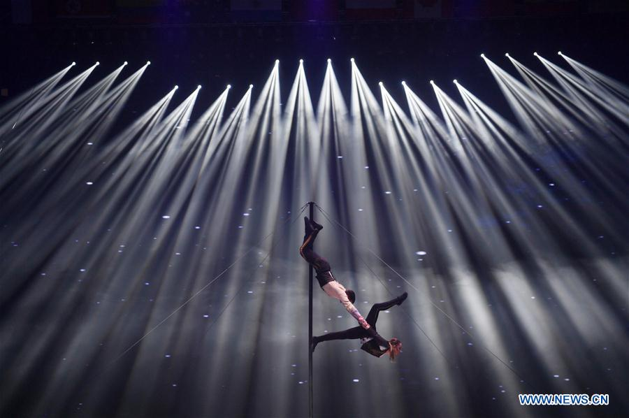 Two acrobats from Russia and Moldova perform during the 17th China Wuqiao International Circus Festival in Cangzhou, north China's Hebei Peovince, Nov. 7, 2019. The 17th China Wuqiao International Circus Festival concluded here on Thursday. Founded in 1987, the biennial festival is regarded as China's longest-running international circus festival, while boasting a wide influence in the field of acrobatics. (Xinhua/Mu Yu)<br/>
