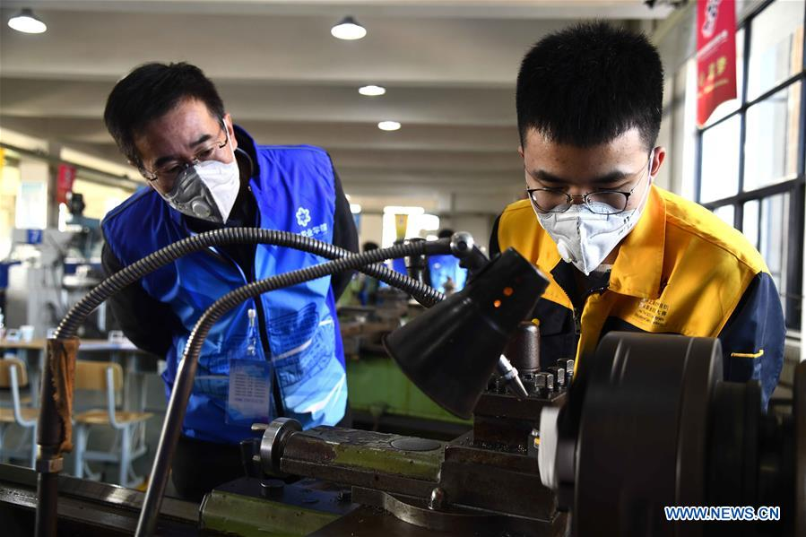 Participants compete in the prototyping contest at Weihai Vocational College in Weihai City, east China's Shandong Province, Nov. 11, 2019. The Shanghai Cooperation Organization (SCO) Countries Vocational Skills Contest kicked off here on Monday. Participants from 20 countries and regions will compete in 13 contest events such as mobile robots, welding, western food cooking and so on. (Xinhua/Guo Xulei)<br/>
