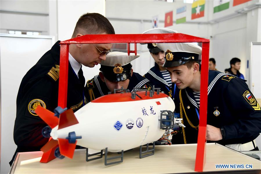 Participants compete in the marine aircraft design and production contest at Weihai Vocational College in Weihai City, east China's Shandong Province, Nov. 11, 2019. The Shanghai Cooperation Organization (SCO) Countries Vocational Skills Contest kicked off here on Monday. Participants from 20 countries and regions will compete in 13 contest events such as mobile robots, welding, western food cooking and so on. (Xinhua/Guo Xulei)<br/>