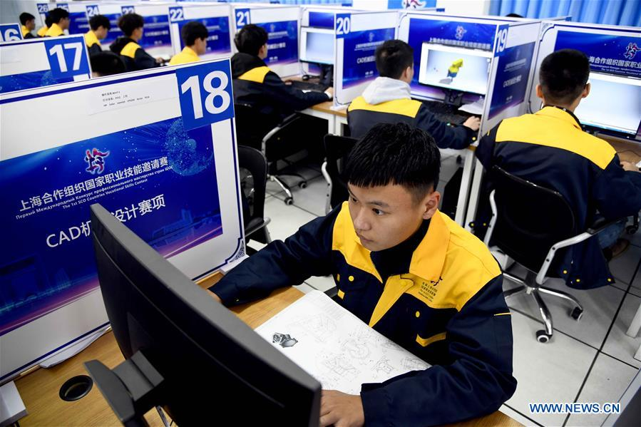 Participants compete in the CAD (computer-aided design) mechanical engineering design contest at Weihai Vocational College in Weihai City, east China's Shandong Province, Nov. 11, 2019. The Shanghai Cooperation Organization (SCO) Countries Vocational Skills Contest kicked off here on Monday. Participants from 20 countries and regions will compete in 13 contest events such as mobile robots, welding, western food cooking and so on. (Xinhua/Guo Xulei)<br/>