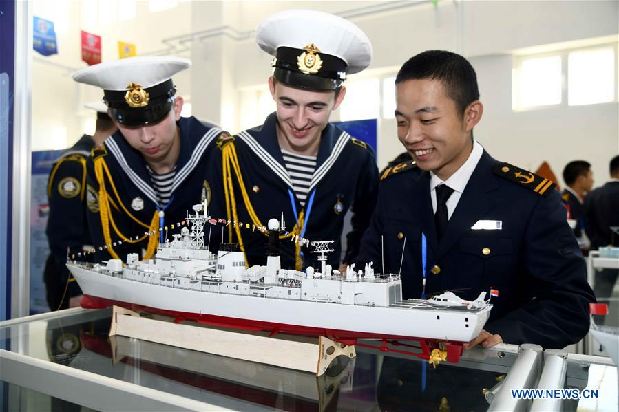 Participants communicate with each other during the marine aircraft design and production contest at Weihai Vocational College in Weihai City, east China's Shandong Province, Nov. 11, 2019. The Shanghai Cooperation Organization (SCO) Countries Vocational Skills Contest kicked off here on Monday. Participants from 20 countries and regions will compete in 13 contest events such as mobile robots, welding, western food cooking and so on. (Xinhua/Guo Xulei)<br/>