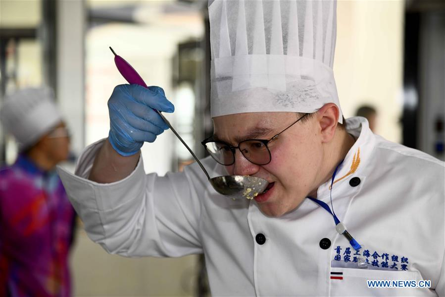 Participants compete in the European food cooking contest at Weihai Vocational College in Weihai City, east China's Shandong Province, Nov. 11, 2019. The Shanghai Cooperation Organization (SCO) Countries Vocational Skills Contest kicked off here on Monday. Participants from 20 countries and regions will compete in 13 contest events such as mobile robots, welding, western food cooking and so on. (Xinhua/Guo Xulei)