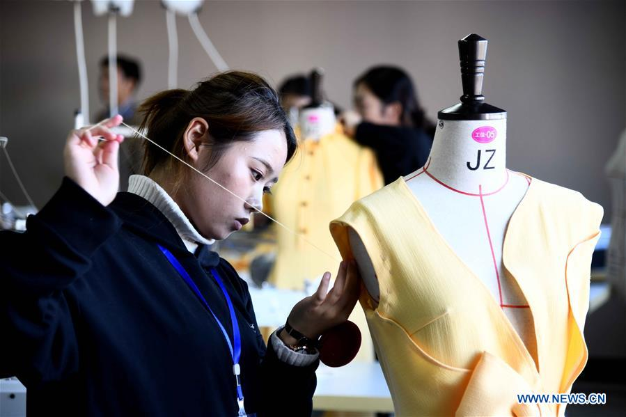 Participants compete in the fashion technology contest at Weihai Vocational College in Weihai City, east China's Shandong Province, Nov. 11, 2019. The Shanghai Cooperation Organization (SCO) Countries Vocational Skills Contest kicked off here on Monday. Participants from 20 countries and regions will compete in 13 contest events such as mobile robots, welding, western food cooking and so on. (Xinhua/Guo Xulei)<br/>