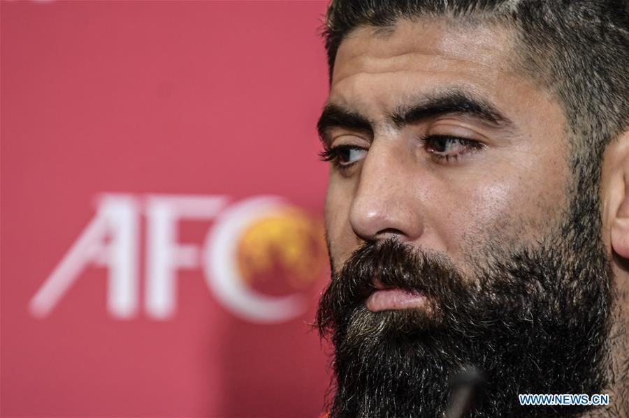 Ahmed Al Salih of Syria reacts during a press conference before the group A match between China and Syria of the FIFA World Cup Qatar 2022 and AFC Asian Cup China 2023 Preliminary Joint Qualification Round 2 in Dubai, the United Arab Emirates, Nov. 13, 2019. (Xinhua/Pan Yulong)<br/>