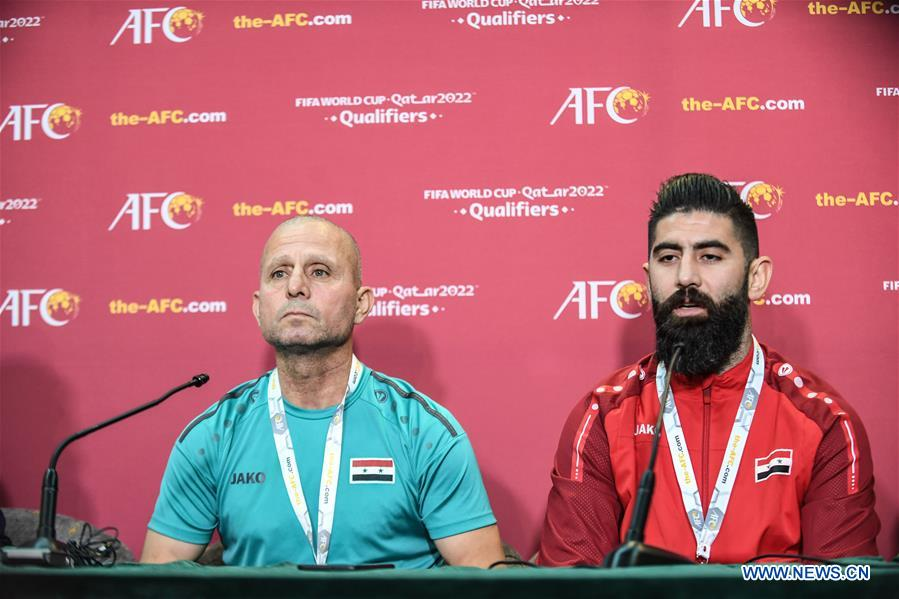 Fajer Ebrahim (L), head coach of Syria, speaks to the media during a press conference before the group A match between China and Syria of the FIFA World Cup Qatar 2022 and AFC Asian Cup China 2023 Preliminary Joint Qualification Round 2 in Dubai, the United Arab Emirates, Nov. 13, 2019. (Xinhua/Pan Yulong)<br/>