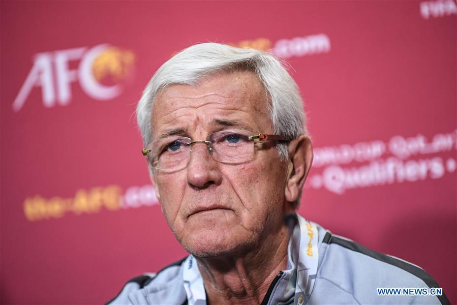 Marcello Lippi, head coach of China, reacts during a press conference before the group A match between China and Syria of the FIFA World Cup Qatar 2022 and AFC Asian Cup China 2023 Preliminary Joint Qualification Round 2 in Dubai, the United Arab Emirates, Nov. 13, 2019. (Xinhua/Pan Yulong)<br/>