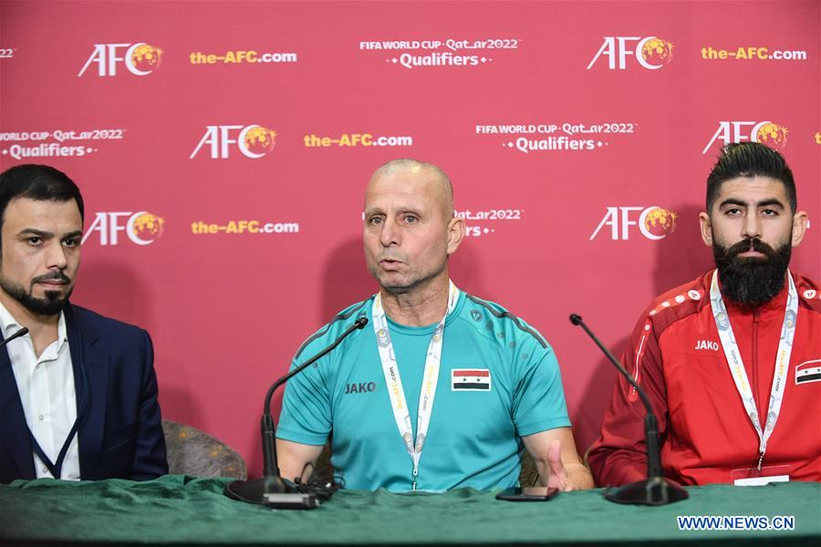 Fajer Ebrahim (C), head coach of Syria, speaks to the media during a press conference before the group A match between China and Syria of the FIFA World Cup Qatar 2022 and AFC Asian Cup China 2023 Preliminary Joint Qualification Round 2 in Dubai, the United Arab Emirates, Nov. 13, 2019. (Xinhua/Pan Yulong)<br/>