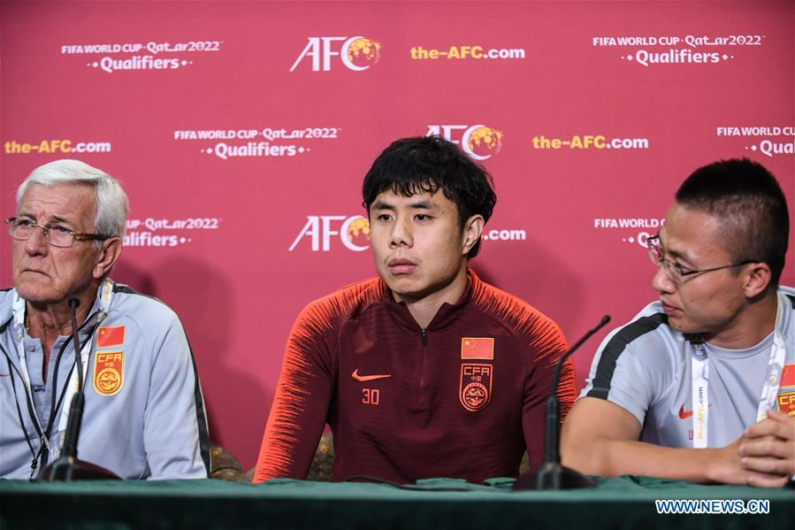 Hao Junmin (C) of China speaks to the media during a press conference before the group A match between China and Syria of the FIFA World Cup Qatar 2022 and AFC Asian Cup China 2023 Preliminary Joint Qualification Round 2 in Dubai, the United Arab Emirates, Nov. 13, 2019. (Xinhua/Pan Yulong)<br/>