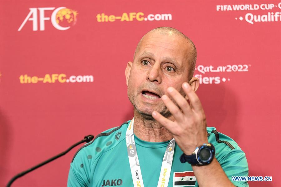 Fajer Ebrahim, head coach of Syria, speaks to the media during a press conference before the group A match between China and Syria of the FIFA World Cup Qatar 2022 and AFC Asian Cup China 2023 Preliminary Joint Qualification Round 2 in Dubai, the United Arab Emirates, Nov. 13, 2019. (Xinhua/Pan Yulong)<br/>