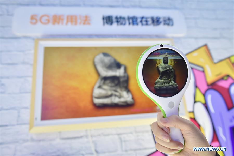 "An exhibitor shows an AR technology that can restore historical relics during the 2019 World 5G Convention in Beijing, capital of China, Nov. 21, 2019. Themed ""5G changes the world, 5G creates the future,"" the 2019 World 5G Convention kicked off Thursday in Beijing. (Xinhua/Peng Ziyang)<br/>"