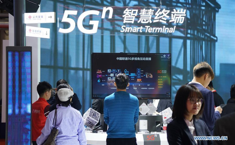 "Visitors look at a 5G intelligent application booth at the 2019 World 5G Convention in Beijing, capital of China, Nov. 21, 2019. Themed ""5G changes the world, 5G creates the future,"" the 2019 World 5G Convention kicked off Thursday in Beijing. (Xinhua/Li Xin)<br/>"
