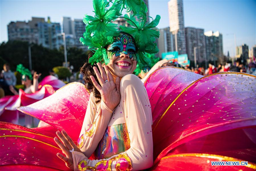 A performer takes part in the Macao International Parade in Macao, south China, Dec. 8, 2019. The parade was held to celebrate the 20th anniversary of Macao's return to the motherland. (Xinhua/Cheong Kam Ka)<br/>