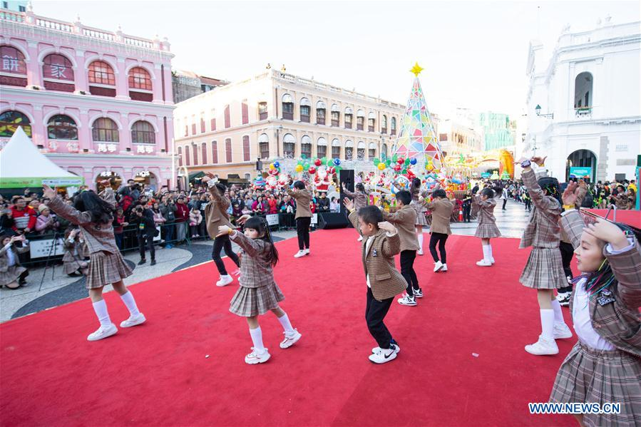 Performers take part in the Macao International Parade in Macao, south China, Dec. 8, 2019. The parade was held to celebrate the 20th anniversary of Macao's return to the motherland. (Xinhua/Cheong Kam Ka)<br/>