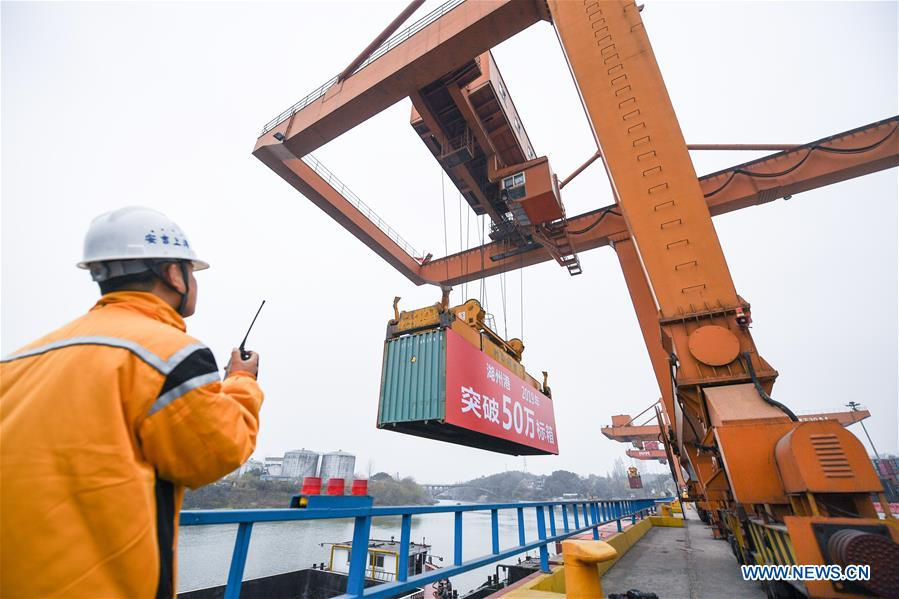 Photo taken on Dec. 17, 2019 shows a container lifted by a gantry crane at a container terminal in Anji County of Huzhou City, east China's Zhejiang Province. The container throughput of the Huzhou Port has exceeded 0.5 million TEU by far this year, while the number of export containers raised 17.2 percent compared with the same period last year. (Xinhua/Xu Yu)<br/>