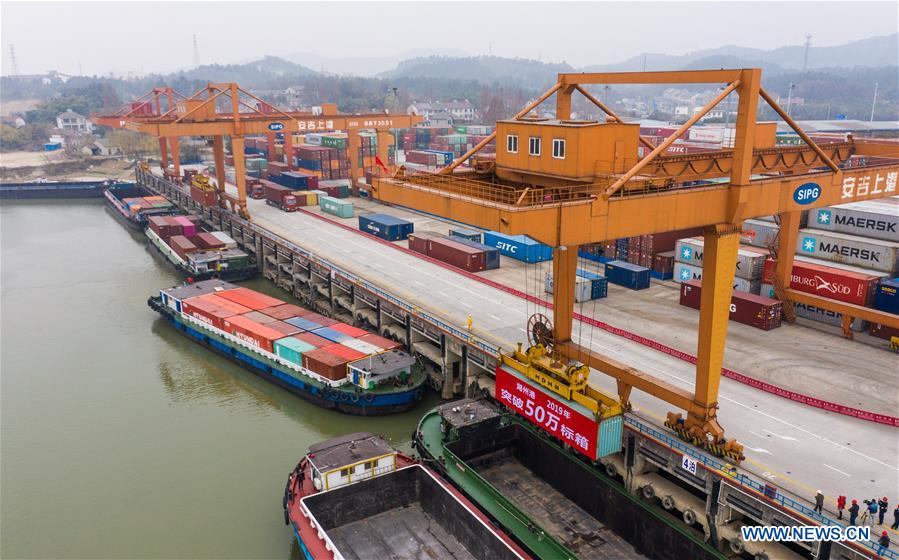 Aerial photo taken on Dec. 17, 2019 shows a container lifted by a gantry crane at a container terminal in Anji County of Huzhou City, east China's Zhejiang Province. The container throughput of the Huzhou Port has exceeded 0.5 million TEU by far this year, while the number of export containers raised 17.2 percent compared with the same period last year. (Xinhua/Xu Yu)<br/>