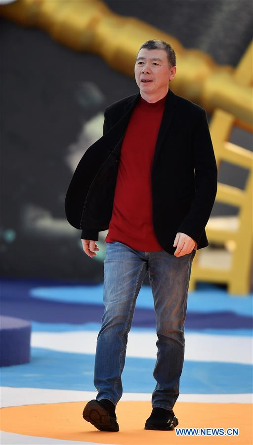 Director Feng Xiaogang makes his red carpet appearance during the closing ceremony of the 2nd Hainan International Film Festival in Sanya, south China's Hainan Province, Dec. 8, 2019. The 2nd Hainan International Film Festival concluded in Sanya on Sunday. (Xinhua/Guo Cheng)<br/>