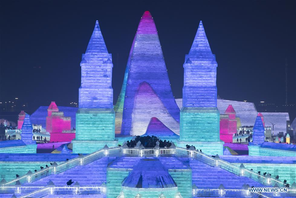 People visit the 21st edition of Ice-Snow World in Harbin, capital of northeast China's Heilongjiang Province, Dec. 23, 2019. (Photo by Zhang Tao/Xinhua)<br/>