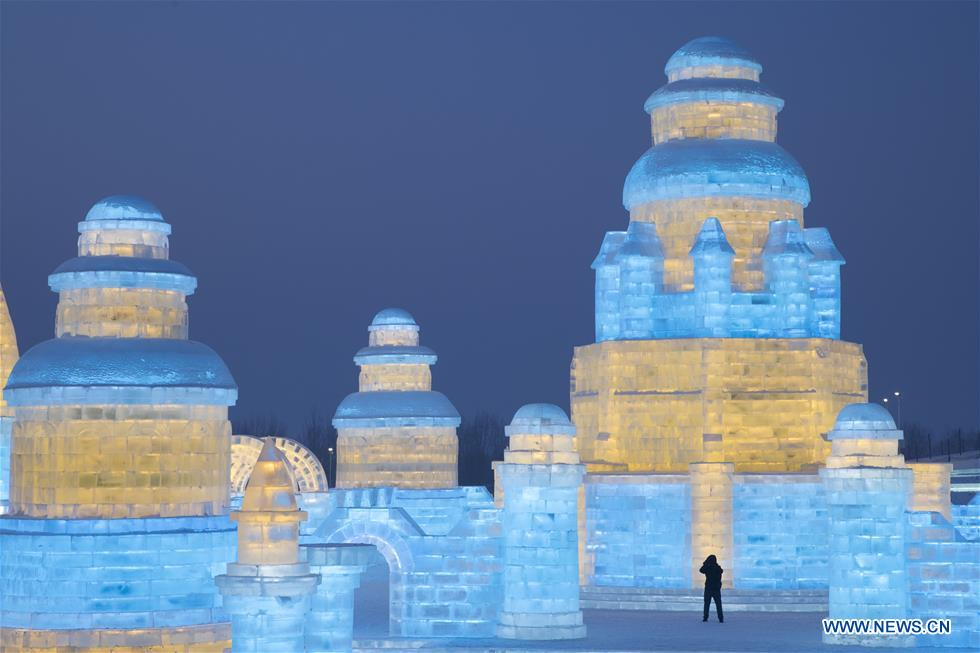 A tourist visits the 21st edition of Ice-Snow World in Harbin, capital of northeast China's Heilongjiang Province, Dec. 23, 2019. (Photo by Zhang Tao/Xinhua)<br/>