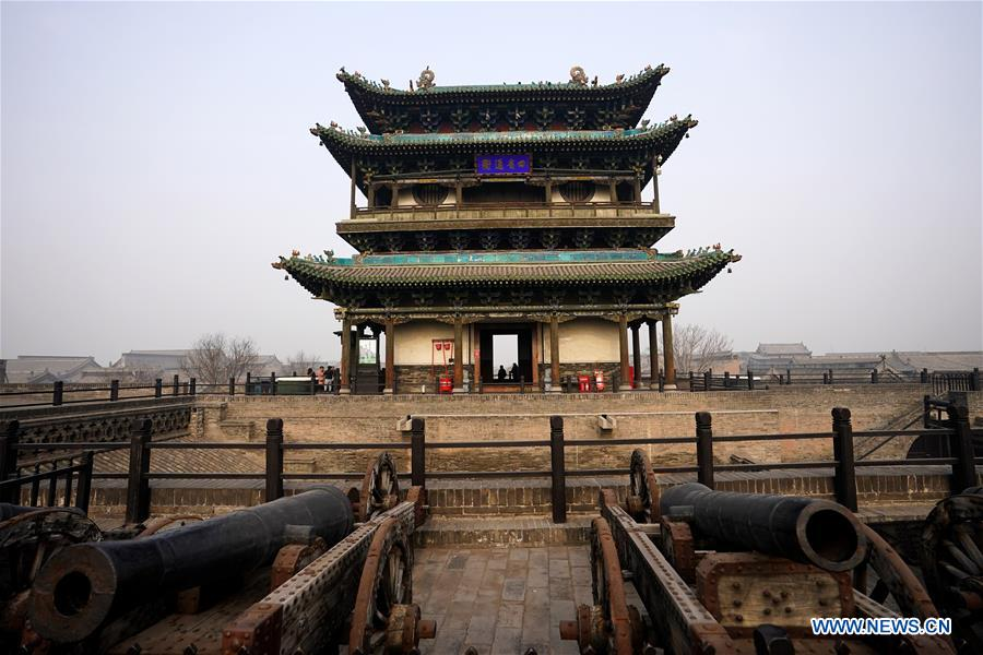 Photo taken on Dec. 25, 2019 shows a gate tower in the ancient city of Pingyao in Jinzhong, north China's Shanxi Province. Pingyao, a UNESCO World Cultural Heritage site in north China's Shanxi Province, is famous for its well-preserved ancient architecture including the city walls. The city boomed in the 19th century as China's financial center, as Shanxi merchants expanded their businesses across the country. Now, the well-preserved compounds of these affluent merchants and some emerging modern elements like souvenir shops, bars, photography festival and theatrical performances have again brought the ancient city to life and made it a popular tourist attraction. (Xinhua/Zhan Yan)<br/>