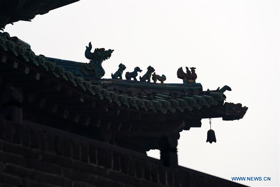 Photo taken on Dec. 25, 2019 shows a part of a building in the ancient city of Pingyao in Jinzhong, north China's Shanxi Province. Pingyao, a UNESCO World Cultural Heritage site in north China's Shanxi Province, is famous for its well-preserved ancient architecture including the city walls. The city boomed in the 19th century as China's financial center, as Shanxi merchants expanded their businesses across the country. Now, the well-preserved compounds of these affluent merchants and some emerging modern elements like souvenir shops, bars, photography festival and theatrical performances have again brought the ancient city to life and made it a popular tourist attraction. (Xinhua/Zhan Yan)<br/>