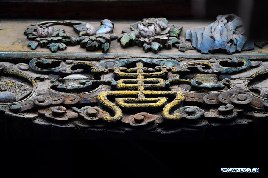 Photo taken on Dec. 25, 2019 shows wooden bas-relief works on a city tower in the ancient city of Pingyao in Jinzhong, north China's Shanxi Province. Pingyao, a UNESCO World Cultural Heritage site in north China's Shanxi Province, is famous for its well-preserved ancient architecture including the city walls. The city boomed in the 19th century as China's financial center, as Shanxi merchants expanded their businesses across the country. Now, the well-preserved compounds of these affluent merchants and some emerging modern elements like souvenir shops, bars, photography festival and theatrical performances have again brought the ancient city to life and made it a popular tourist attraction. (Xinhua/Zhan Yan)<br/>