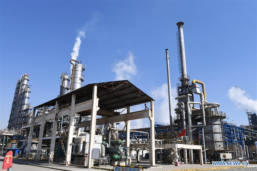 Facilities are under operation at Lanzhou Petrochemical Company in Lanzhou, northwest China's Gansu Province, Feb. 12, 2020. Lanzhou Petrochemical Company has rushed to work to meet the increasing need of medical material after the novel coronavirus outbreak. (Xinhua/Chen Bin)<br/>