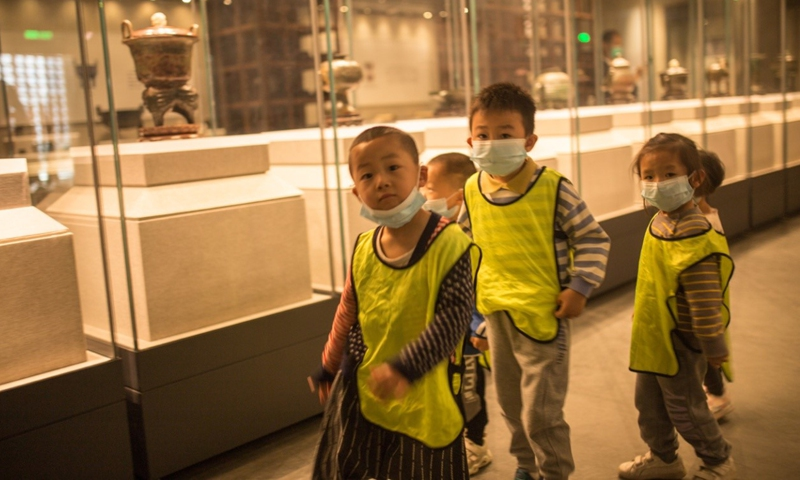 Children learn about traditional culture at Confucius Museum, Qufu of Jining. Photo: Shan Jie/GT